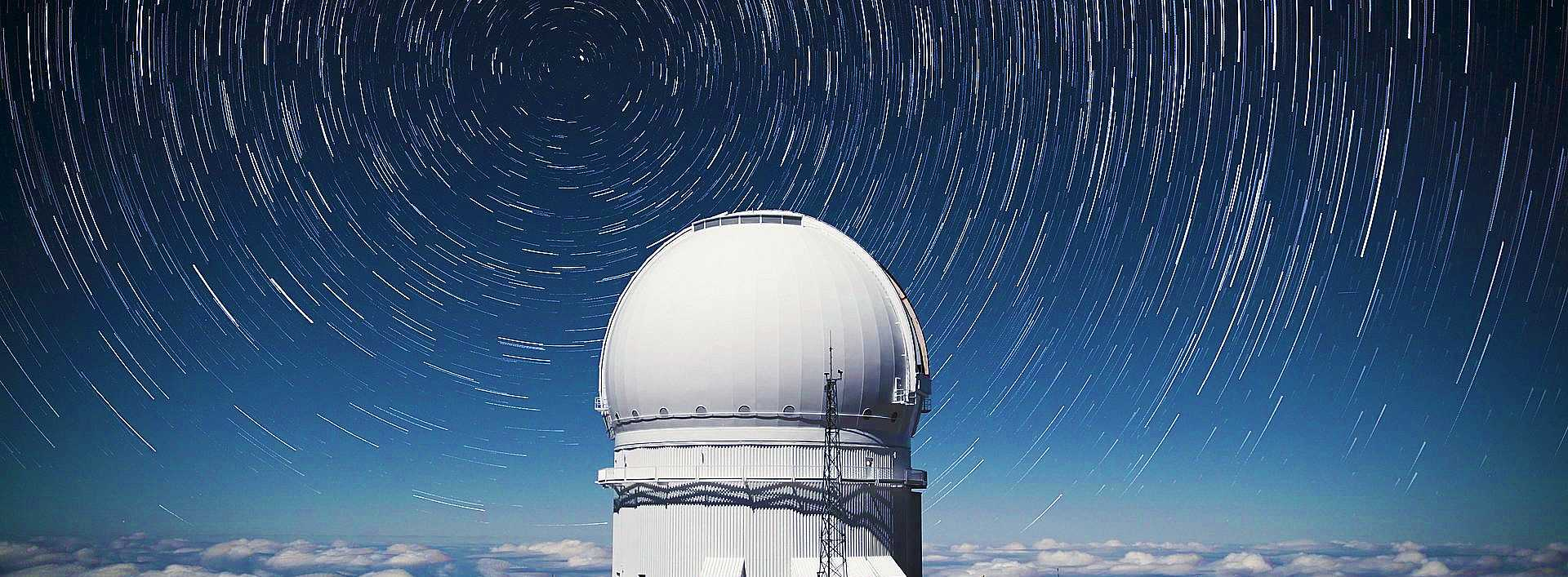 Photo of the Canada-France-Hawaii telescope on Mauna Kea volcano
